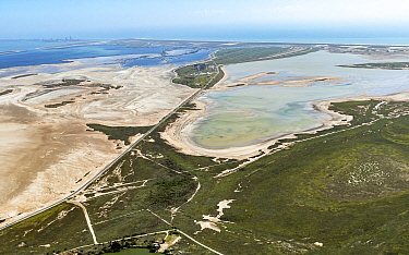 Aerial view of Lower Rio Grande Valley and coast north of Rio Grande river to South Padre Island, Cameron County, Texas, USA. July 2019.