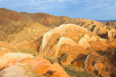 Eroded hills of sedimentary conglomerate and sandstone, in morning light. Zhangye National Geopark, China Danxia UNESCO World Heritage Site, Gansu Province, China. 2018.