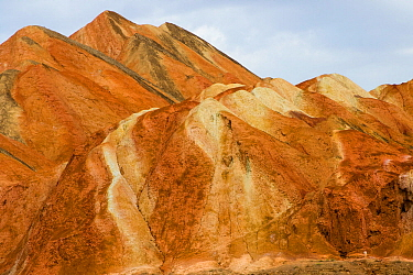 Eroded hills of sedimentary conglomerate and sandstone. Zhangye National Geopark, China Danxia UNESCO World Heritage Site, Gansu Province, China. 2018.