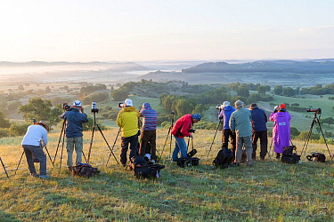 Group of tourists photographing Bashang Grassland landscape in morning. Near Zhangjiakou, Hebei Province, Inner Mongolia, China. 2018.