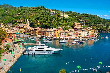 Yacht in harbour of Portofino fishing village. Italian Riviera, Portofino, Genoa, Italy. May 2019.