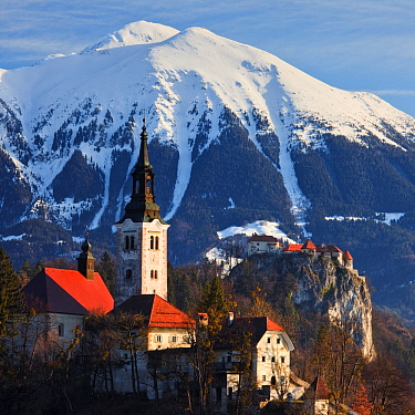 Bled Island and Assumption of Mary's Pilgrimage Church, Bled Castle and the Julian Alps beyond, Bled, Gorenjska, Slovenia, Europe, March 2009