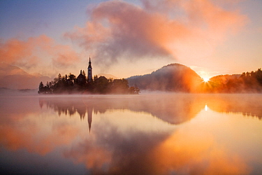 Church of the Assumption and Lake Bled at sunrise, Bled, Slovenia, UK, October 2007
