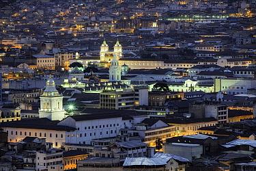 Quito illuminated at sunset, Ecuador, August 2010.