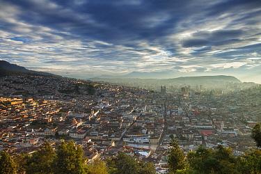 View form Panecillo Hill at sunrise towards La Basilica Del Voto Nacional, Quito, Ecuador, August 2010.