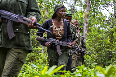 Portrait of female ecoguard / ranger, with colleagues in Salonga National Park, Democratic Republic of Congo. May 2017. There are 16 women who work as Ecoguards in Salonga National Park