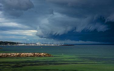 Storm clouds above Sandringham yacht club (in Por Philip Bay).? Sandringham, Victoria, Australia. ?May 2020.