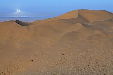 Drifting sand dunes and solar power station,Gobi desert, near Dunhuang, Gansu, China.