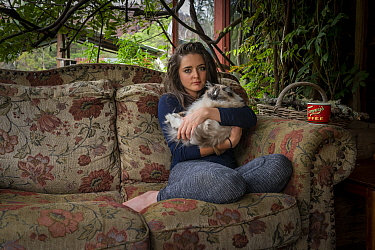 Emily Small,one of the founders of the Goongerah Wombat Orphanage, sits on the veranda of her house, with her ragdoll cat Cotton', shortly after the 2019/20 bushfires devastated the area. Emily's...