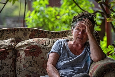 Sharon Small, one of the founders of Goongerah Wombat Orphanage, sitting at home after the 2019/20 bushfires devastated the area. Sharon's house was spared, but she lamented the loss of her surrou...