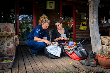 Forest and wildlife Officer from the Department of Land, Water and Planning (DEWLP) Abby Smith visits and drops off some supplies to the founder of Goongerah Wombat Orphanage, Emily Small, soon after...