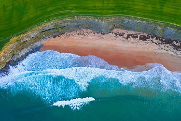 Aerial view of waves rolling over Langre beach, Cantabria, Spain, February.