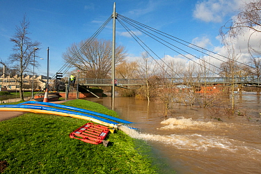 Floodwater being pumped by the Environment Agency from a road into the River Severn, Worcester, England, UK. February 2020.