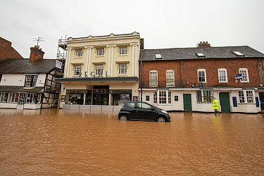 Flooded Regal Theatre and abandoned vehicle, Teme Street, Tenbury Wells, Storm Dennis, Worcestershire, 16 February 2020.