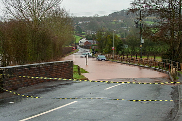 Flooded B4203 with two broken down vehicles, Storm Dennis, River Frome, Bromyard, Herefordshire. 16 February 2020.