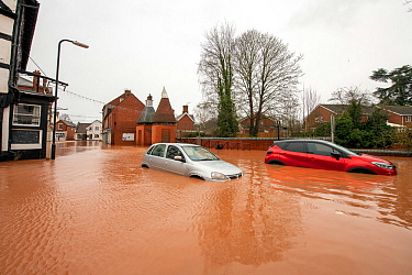 Flooded Cross Street, Tenbury Wells with two abandoned vehicles, Storm Dennis, Worcestershire, 16 February 2020.