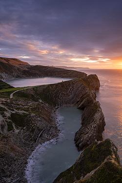 Stair Hole at sunrise, Lulworth Cove, showing 'Lulworth Crumple' strata (folded limestone), Dorset, UK. November.
