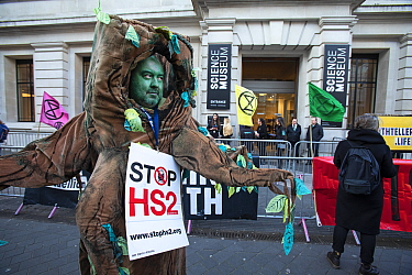 A protestor campaigning against HS2 High speed rail, dressed as an ancient tree' outside the Science Musuem London.February, 2020.