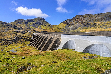 Dam at Llyn Stwlan used for pumped storage hydroelectricity generation situated in the Moelwyn Mountains above Tanygrisiau reservoir near Blaenau Ffestiniog, North Wales, UK, April 2018.