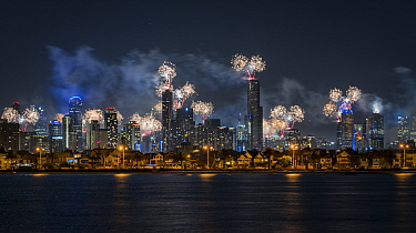 Fireworks over Melbourne city skyline for New Year celebrations. View from Port Philip Bay, St Kilda, Victoria, Australia. January 2018.