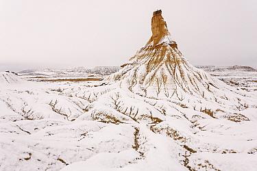 Snow covered Castildetierra mountain and surrounding badlands. Bardenas Reales Natural Park. Navarre. Spain. December 2008.