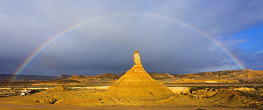Rainbow over badlands and Castildetierra mountain rock formation. Bardenas Reales Natural Park. Navarre, Spain. February 2015.