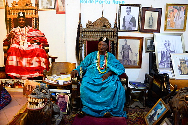 King of Porto Novo, Toffa IX sitting on throne chair in the palace courtroom, surrounded by photographs, Benin, 2020.