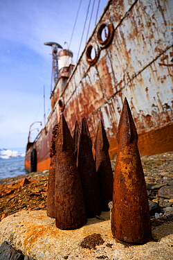 Whaling harpoon tips lie next to the ship Petrel that was used for whale hunting in Antarctic waters. It now stands grounded at Grytviken, South Georgia Island, Antarctica.