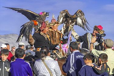 Winners of Eagle festival competition near Ulgii, Western Mongolia. October 2011.