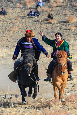 Male-female horse race, at the Eagle Hunters festival near Ulgii, Western Mongolia. Medium repro only