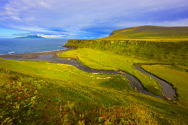 Tundra and estuary, Onekotan Island, Kuril Islands, Russia. Makanrushi Island, which is northwest of Onekotan Island, can be seen in the distance. A volcanically and seismically active island, Onekota...