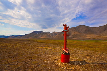 Marker designating the location where the Arctic Circle intersects the 180th meridian in the Siberian tundra of the Chukotka Autonomous Okrug. Chukotka, Siberia, Russia.