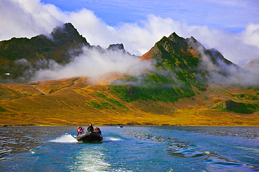 Ecotourists exploring Bukhta Natalia (Natalia Bay) in the Koryaksky Nature Reserve, Kamchatka Peninsula, Russia.