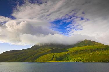 Nemo Peak, a stratovolcano and Black Lake (Lake Chyornoye), a crescent-shaped crater lake, on uninhabited Onekotan Island in the Kuril Islands, Russia.