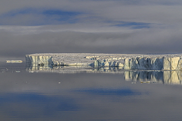 Iceberg reflected in water, Franz Jozef Land, Arctic Russia. July 2019.