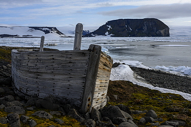 Abandoned boat on beach of Jozef Land, Arctic Russia. July 2019