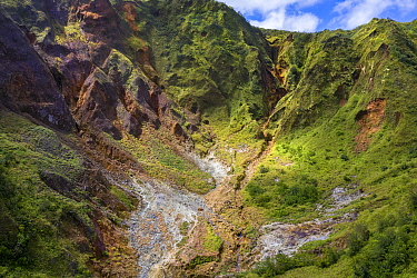 Mountainside with hot mineral streams, on active volcano. Tourists in valley. Valley of Desolation, Morne Trois Pitons National Park, Dominica, Lesser Antilles. 2020.