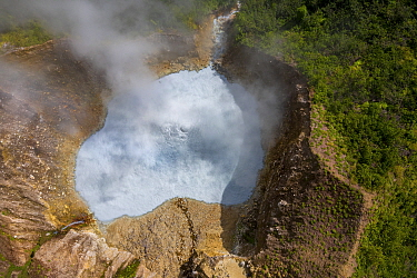 Aerial view of steam and gases rising from Boiling Lake, a water filled fumarole on active volcano. In cloud forest, Morne Trois Pitons National Park, Dominica, Lesser Antilles. 2020.