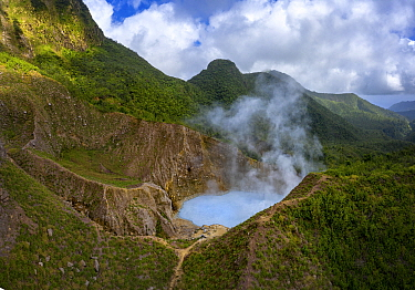 Steam and gases rising from Boiling Lake, a water filled fumarole on active volcano, surrounded by cloud forest. Morne Trois Pitons National Park, Dominica, Lesser Antilles. 2020.