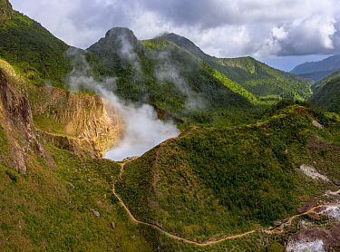Steam rising from Boiling Lake, a sulphur lake on active volcano, surrounded by cloud forest. Morne Trois Pitons National Park, Dominica, Lesser Antilles. 2020.