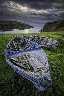 Derelict boats overlooking bay. Spiggie, Scousburgh, Shetland, Scotland, UK. July 2016.