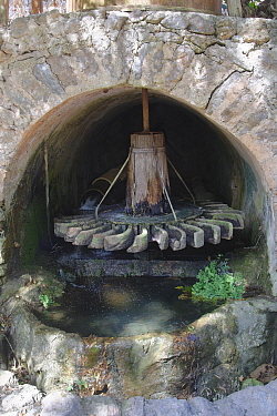 Water driven potter's mill for grinding clay, at La Granja mansion, a museum of Mallorca's traditions and history, Esporles, Mallorca, August 2018.