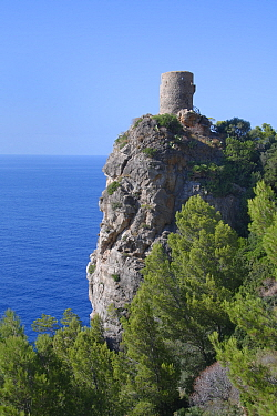 Torre Verger medieval watchtower on a high coastal cliff top at the Mirador de Ses Animes, near Banyalfufar, Mallorca north coast, August 2018.