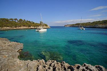 Sailing yachts moored in Cala Mondrago Bay, Mondrago Natural Park, Santanyi, Mallorca, May 2019.