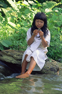 Maya boy with frog, Lacandon rainforest, Mexico