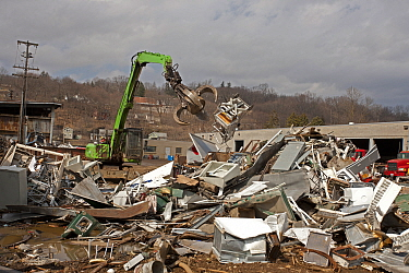 Fridges and various other metals in a large pile with machinery at Recycling Center, Ithaca, New York, USA, property released.