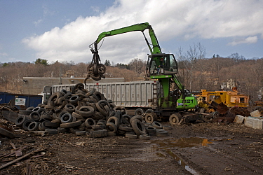 Machinery lifting tyres, Recycling Center, Ithaca, New York, USA, property released.