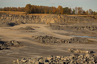 Stone quarry, mining Onandaga limestone with Marcellus shale seen as upper layer, New York, USA, October 2013.
