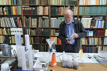 Entomologist with sample of insects caught in malaise trap. Long-term monitoring has revealed a 75% decline in insect biomass over 27 years. Entomological Society Krefeld, Germany 2019.