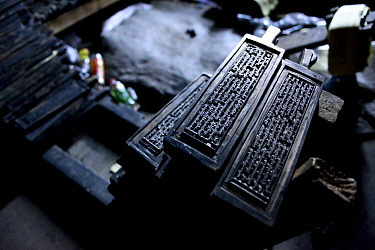 Wooden plates used to print Buddhist prayers. Palpung Monastery, Kham, Dege County, Garze Tibetan Autonomous Prefecture, Sichuan, China. 2016.